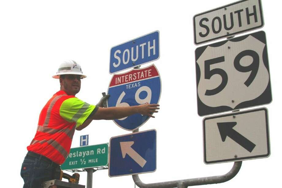 Crews with the Texas Department of Transportation erect signs on a new portion of I-69 in Houston. Photo: Submitted