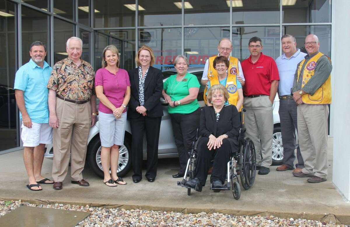 Cleveland Lions Club is the winner of a Keep Cleveland Beautiful drawing for a 2015 Ford Fiesta. The ticket bearing the club's name was picked from a barrel of 173 tickets by Advocate Editor Vanesa Brashier. The tickets were sold for $100. Club members did not purchase a ticket on behalf of the club but Alfred Anderson, owner of Anderson Ford Mercury in Cleveland, paid for tickets for several local organizations including the Lions Club. Pictured left to right are Cleveland Mayor Niki Coats, Alfred Anderson, Teresa Coats (KCB treasurer), Frieda Joyce (KCB president), Sharon Anderson (Lions Club member and part of the Anderson Ford family), Jim and Glinda Plumlee (Lions Club), Jean McAdams (seated and KCB member), Thomas Higgins (Lions Club president), Mike Penry (Lions Club and Cleveland City Councilman) and John Simpson (Lions Club).