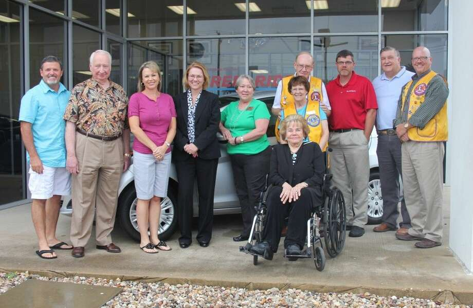 Cleveland Lions Club is the winner of a Keep Cleveland Beautiful drawing for a 2015 Ford Fiesta. The ticket bearing the club's name was picked from a barrel of 173 tickets by Advocate Editor Vanesa Brashier. The tickets were sold for $100. Club members did not purchase a ticket on behalf of the club but Alfred Anderson, owner of Anderson Ford Mercury in Cleveland, paid for tickets for several local organizations including the Lions Club. Pictured left to right are Cleveland Mayor Niki Coats, Alfred Anderson, Teresa Coats (KCB treasurer), Frieda Joyce (KCB president), Sharon Anderson (Lions Club member and part of the Anderson Ford family), Jim and Glinda Plumlee (Lions Club), Jean McAdams (seated and KCB member), Thomas Higgins (Lions Club president), Mike Penry (Lions Club and Cleveland City Councilman) and John Simpson (Lions Club). Photo: Vanesa Brashier