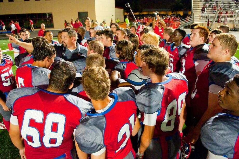 Tomball head coach Danny Ramsey speaks to his team following a game during the 2014 season. Cougars went 3-7 overall and 1-6 in District 19-5A play.