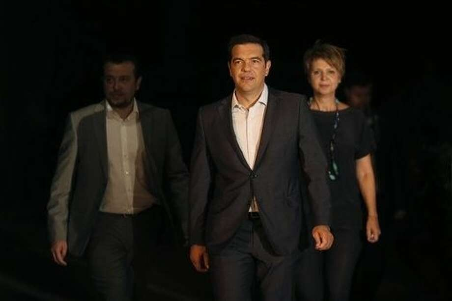Greek Prime Minister Alexis Tsipras announced his government's resignation and called early elections Thursday, seeking to consolidate his mandate to implement a new three-year international bailout that sparked a rebellion within his radical left Syriza party. Photo: Petros Giannakouris