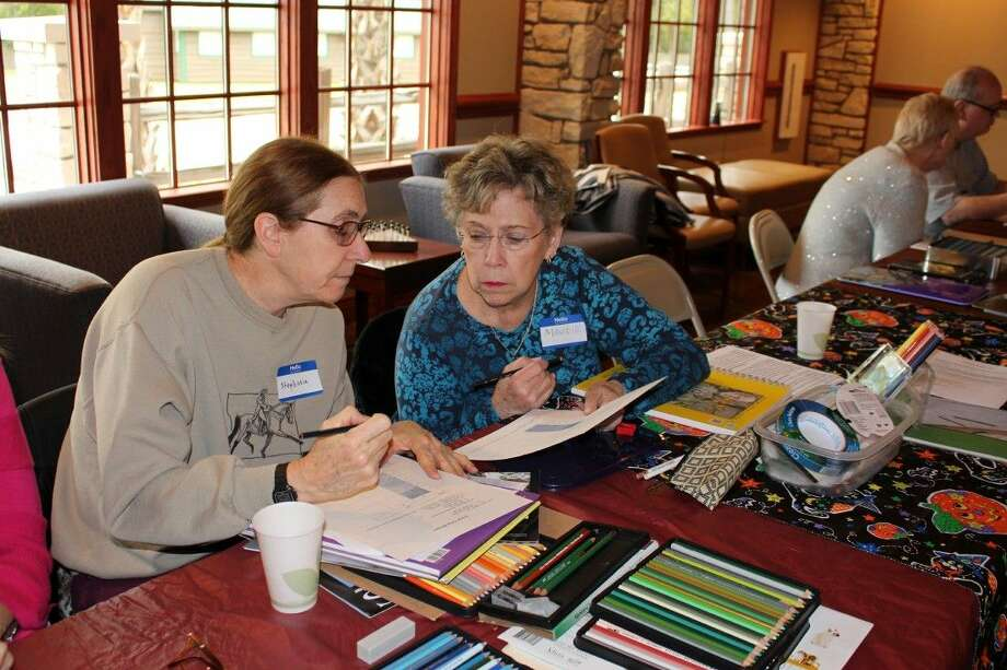 Stephanie Clark (left) participates in colored pencil class at Big Stone Lodge. Photo: Submitted