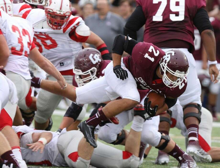 Staff photo by Alan WarrenCinco Ranch's Jonathan Lugo dives for yards against Memorial Sept. 13 at Rhodes Stadium in Katy. To view or purchase this photo and others like it, go to HCNPics.com. Photo: Alan Warren