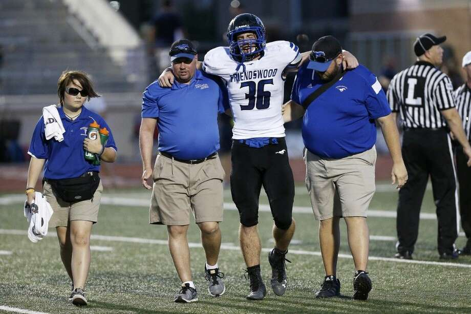 Photo by Paul CacciapagliaFriendswood linebacker Casey Thurman is helped off the field Thursday after sustaining an injury.
