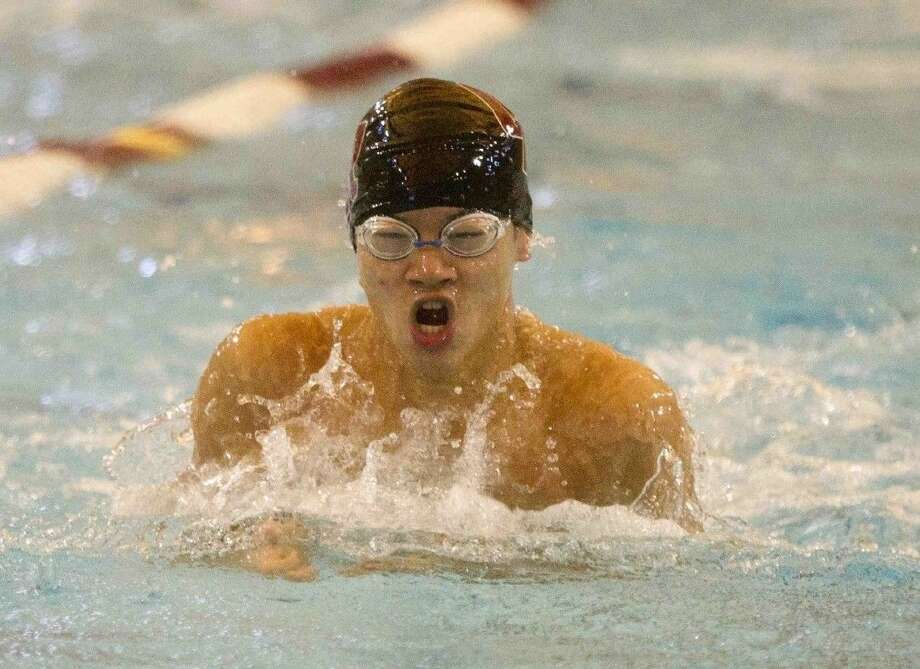 Cinco Ranch's Christopher Hung competes in the boys 200-yard medley relay during the Region 5-6A swimming and diving championships Feb. 6, 2016, in Shenandoah. The Cougars made the TISCA All-State first team. Photo: Jason Fochtman