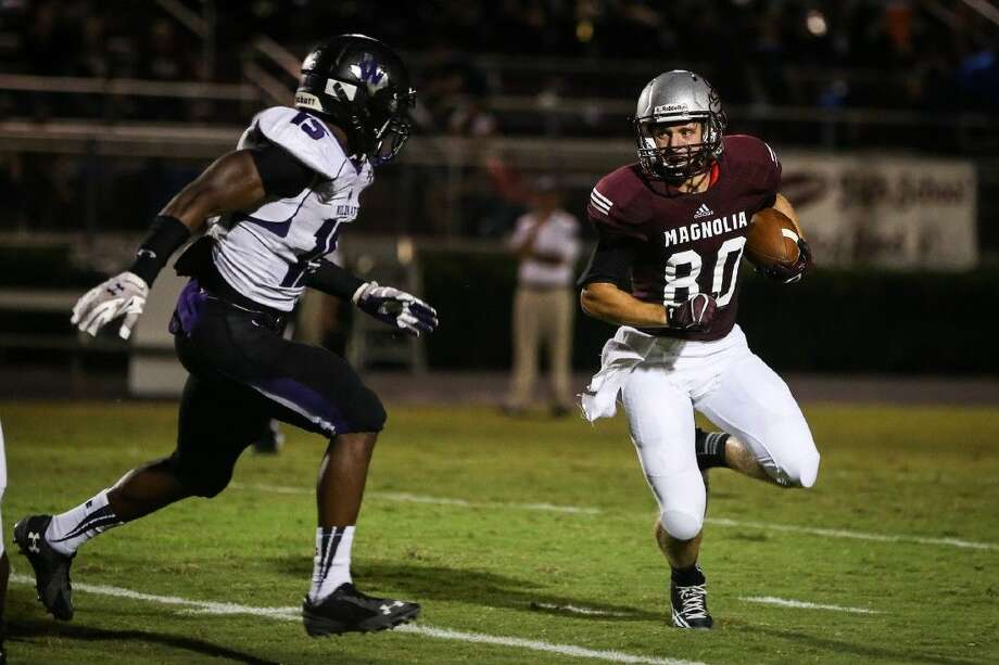 Magnolia's Galvin Culberson (80) runs a play during the high school football game against Willis on Friday, Sept. 12, 2014, at Magnolia High School. To view or purchase this photo and others like it, go to HCNPics.com. Photo: Michael Minasi