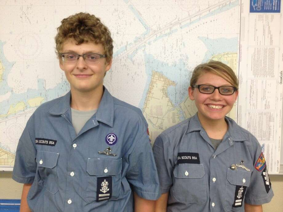 Kevin De Maria and Alexandra Meyers proudly show their Ship 2322 shipmates their recently earned silver dolphin Sea Scout SEAL badges. Photo by Karen Raboin