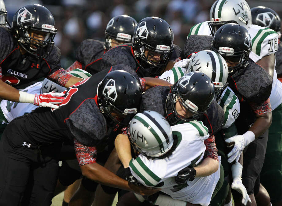 Austin's defense stops Hightower's Santres Broussard during their District 23-6A game Sept. 12 at Mercer Stadium in Sugar Land. The Bulldogs are 2-2 in district play with four games remaining. To view or purchase this photo and others like it, go to HCNPics.com. Photo: Staff Photo By Alan Warren