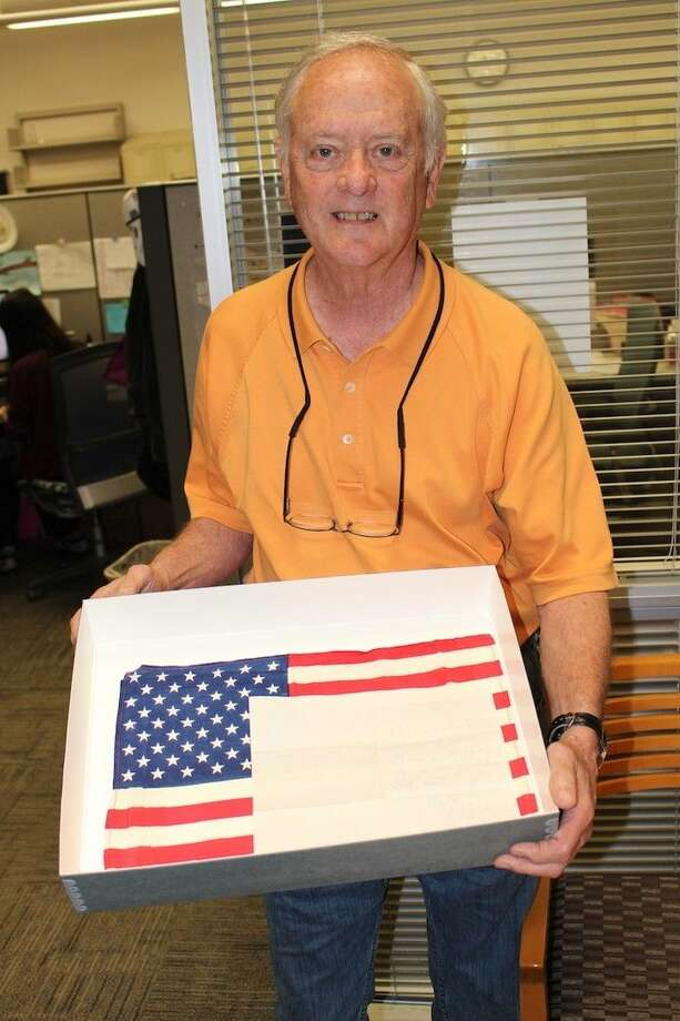 Former JSC flight director Milt Heflin holds Pete Conrad's Gemini V flag and handwritten note, both of which were recovered thanks to the efforts of UCHL archivist Lauren Meyers.