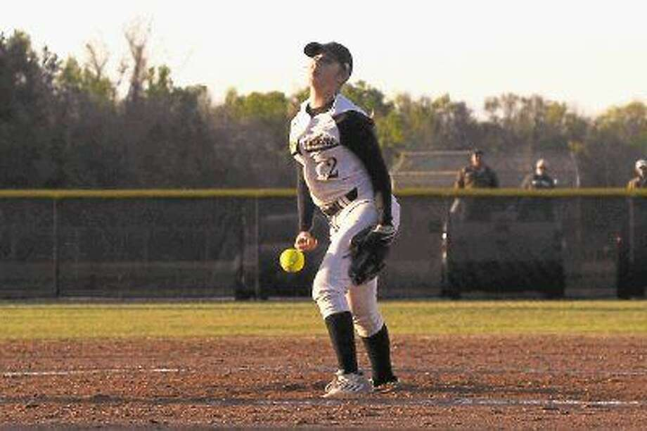 Madisyn Frazier hit a triple, a double and two singles, going four-for-five at the plate, in the Liberty Lady Panthers' 9-2 bi-district win over Orangefield on Thursday night, April 28, at Lee High School in Baytown. She is shown here pitching at home against Tarkington back in March. Photo: Casey Stinnett
