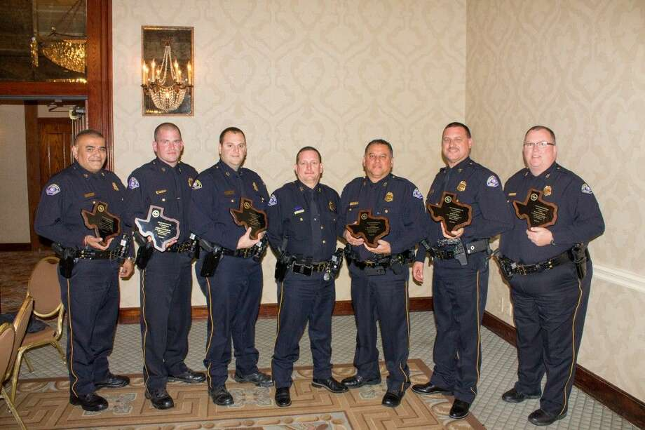Pasadena Fire Marshal David Brannon (center) is flanked by members of the Fire Marshal's Office's investigation division recently recognized by the Texas Chapter of International Association of Arson Investigators: (from left) Deputy Marshals Larry Suniga, Chris Shannahan, Jeffrey Allen, Fire Marshal David Brannon, Raphael Chacon, Assistant Fire Marshal Aaron Bell and Deputy Fire Marshal Raymond Coven. Photo: SUBMITTED