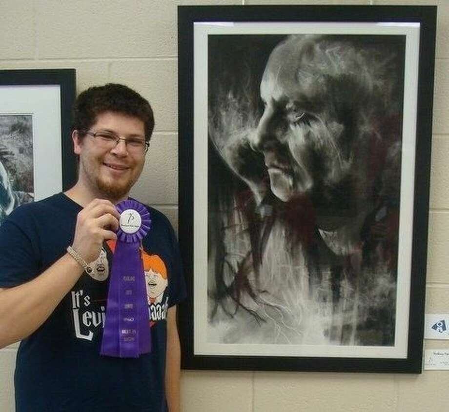 Jon-Michael Hensley won the Best of Show Award with his charcoal drawing.