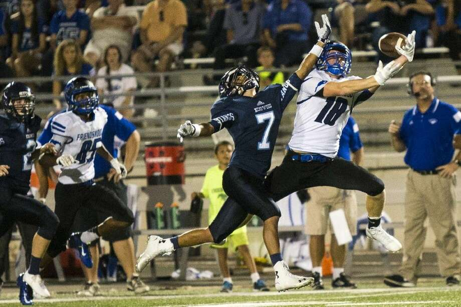 Staff photo by Andrew BuckleyFriendswood wide receiver Joey Crespo (18) attempts a leaping catch against Humble Kingwood Thursday night at Turner Stadium. Photo: Andrew Buckley