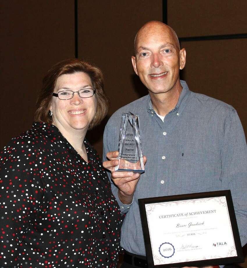 Pictured is Belmont Village West University Senior Executive Director, Rachelle Park and award-winner, Bruce Goodrich.