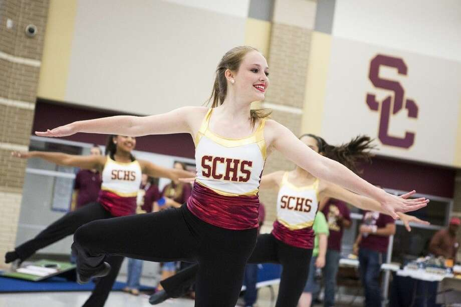 The Summer Creek cheerleaders perform during the Bulldogs & Hot Dogs Community Event on Aug. 20, 2015, at Summer Creek High School. Photo: ANDREW BUCKLEY