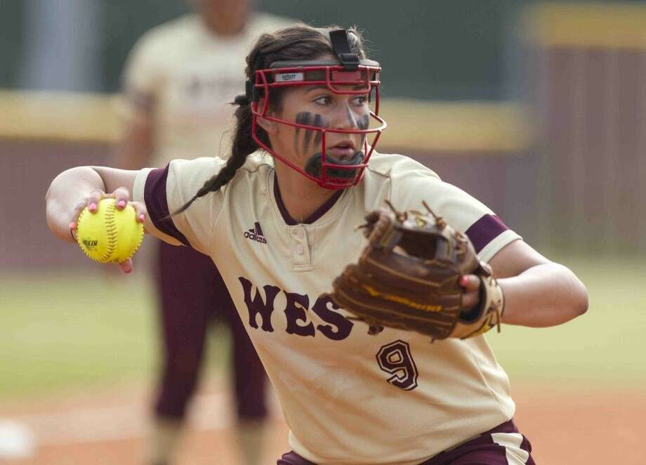 Magnolia West pitcher Ariana Adams throws to first for an out during the first inning of a Region III-5A bi-district softball playoff game Thursday at Magnolia West High School. Go to HCNpics.com to purchase this photo and others like it.