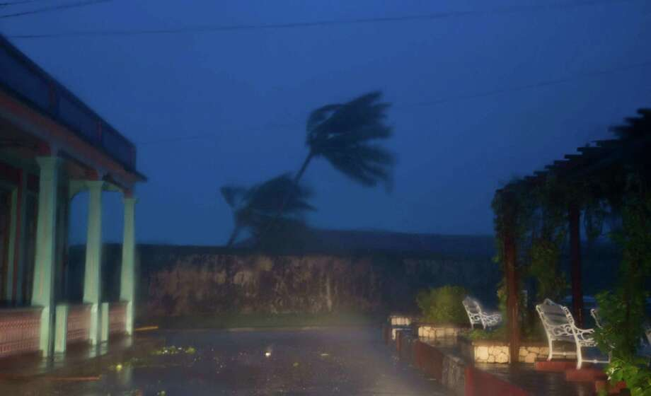 The high winds of Hurricane Matthew roar over Baracoa, Cuba, Tuesday, Oct. 4, 2016. The dangerous Category 4 storm blew ashore around dawn in Haiti. It unloaded heavy rain as it swirled on toward a lightly populated part of Cuba and the Bahamas. (AP Photo/Ramon Espinosa) Photo: Ramon Espinosa, Associated Press / Copyright 2016 The Associated Press. All rights reserved.