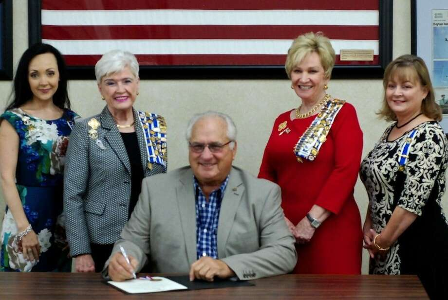 "Staff photo by Casey StinnettDayton Mayor Felix Skarpa prepares to sign the City's proclamation naming the week of Sept. 17 as ""Constitution Week"" and to present the proclamation to representatives from the Daughters of the American Revolution, from left, Brandie Thompson, DAR Regent Ada Fay Schmidt, Linda Jamison, and Gay Dinsmore. Photo: Casey Stinnett"