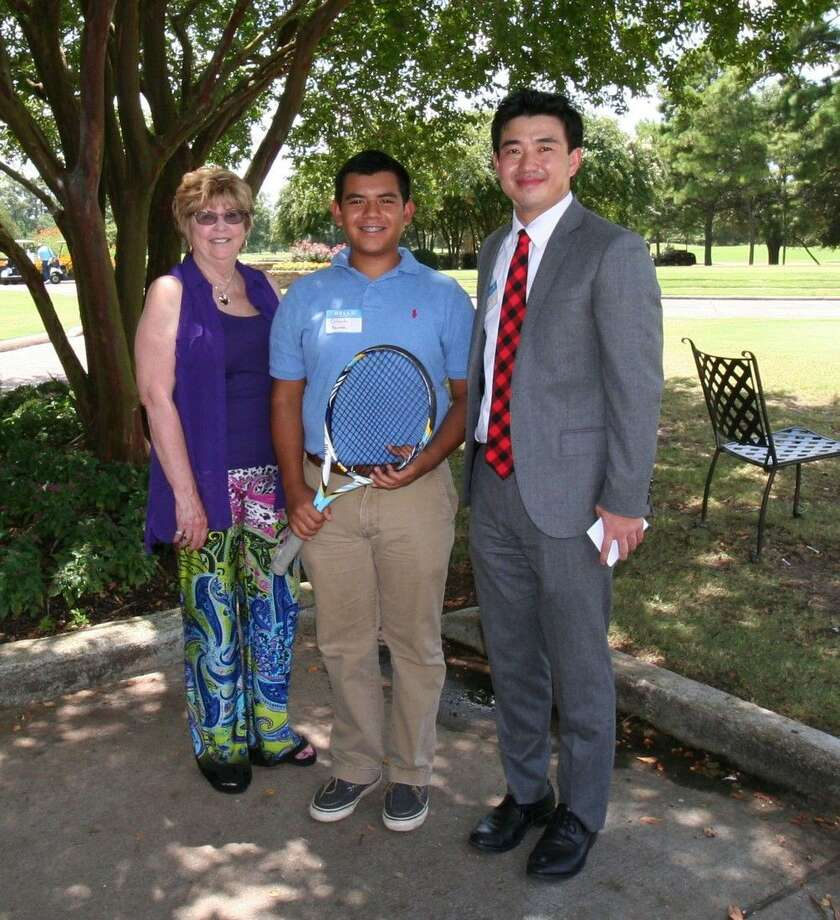 HTA Executive Director Cheryl Hultquist Horvath, left, and Jeff Lin, right, president of HTA, congratulate Orlando Herrera of Clear Lake High, center, for his scholarship).