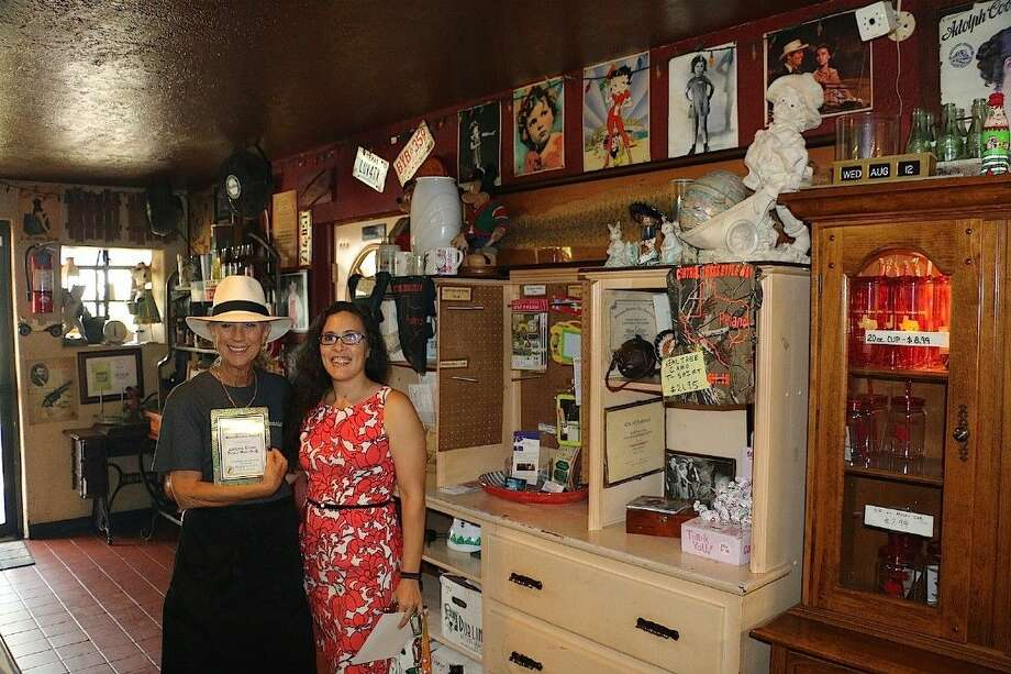 Ruth Le Clere, owner of Central Texas Bar-B-Q, accepts the August Business Beautification Award from Keep Pearland Beautiful's Fay Watson. Photo: Fay Watson
