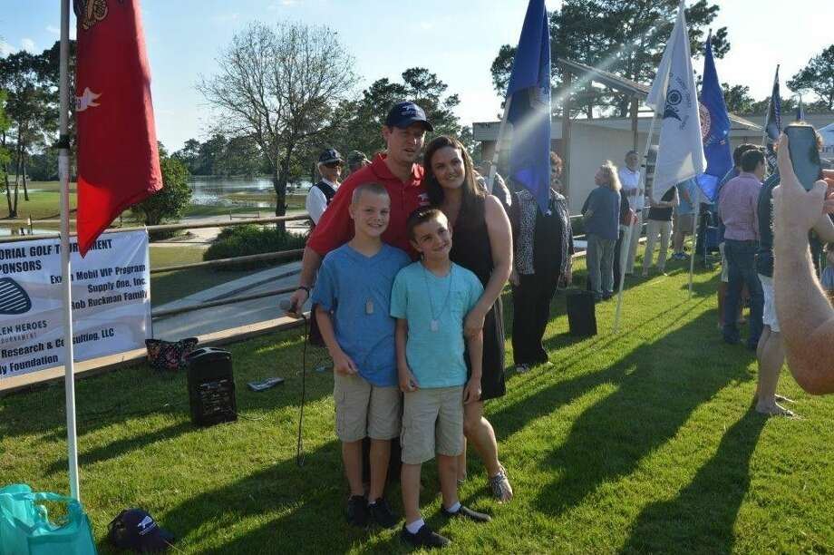 Scott Mitchell, Kingwood Fallen Heroes founder with Brandon Bury's widow, Heather, and sons, Cole and Cade.