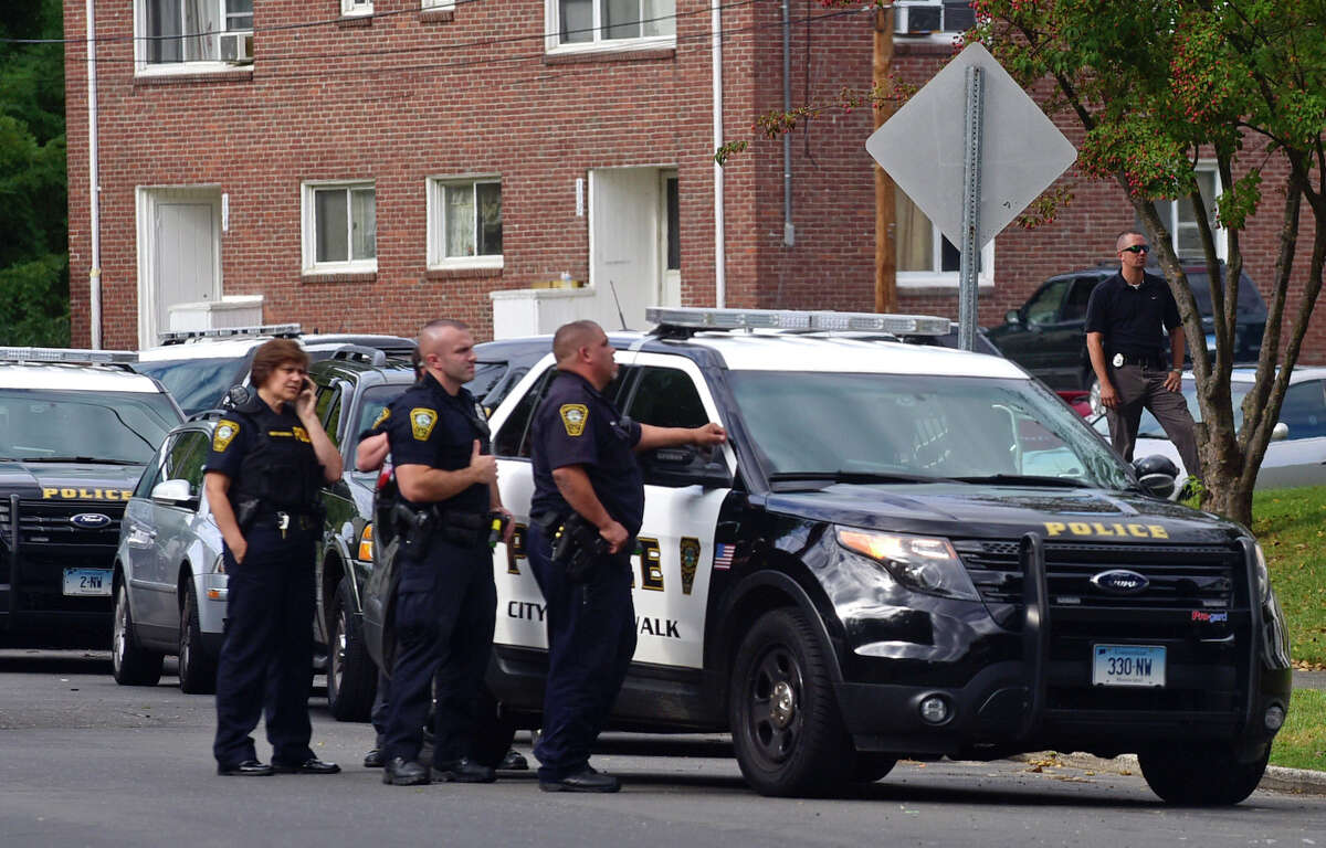 Norwalk police respond to Colonial Village on Suncrest Road in Norwalk, Conn. where reports of an armed suspect forced police to clear the area and bring in the tactical unit Tuesday, October 4, 2016.