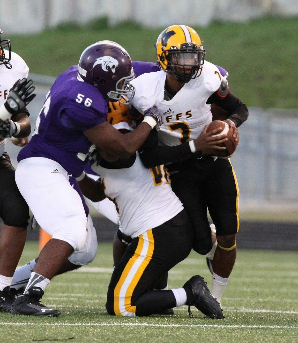 Ridge Point's Michael Obi grabs Marshall's Jeremy Smith during a 2014 District 23-5A game at Hall Stadium in Missouri City. The Panthers and Buffalos have both won district titles during the last three years.