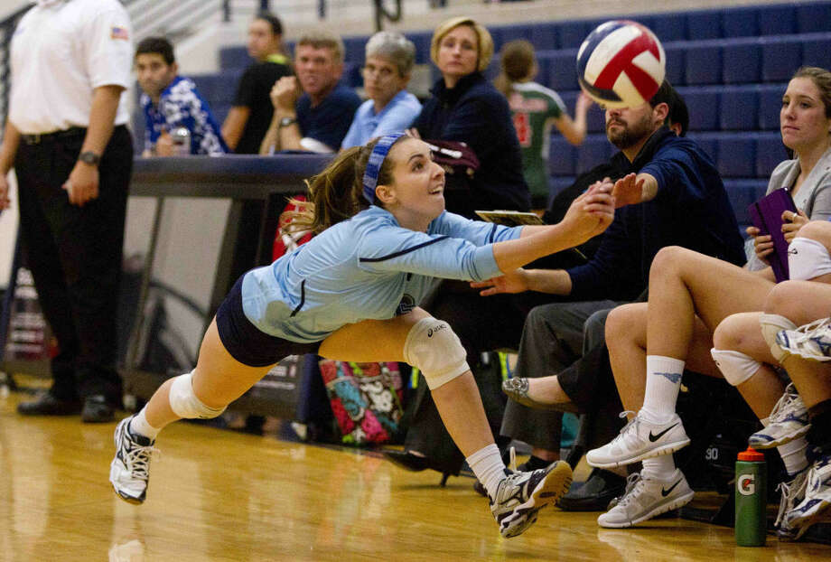 Kingwood's Nicole Walters dives for the ball during a high school volleyball game Tuesday. Photo: Jason Fochtman