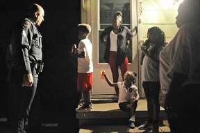 Midland Police Sgt. Jimmy Young visits with community members during National Night Out on Tuesday, Oct. 4, 2016. James Durbin/Reporter-Telegram
