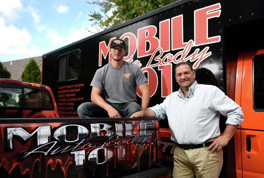 John Castellana and his son, John Castellana Jr., pose by their mobile auto body repair vehicle outside their home in the Cos Cob section of Greenwich, Conn. Monday, Oct. 3, 2016. Two months ago the two began a repair business called Mobile Auto Body 101 where they travel to their clients. Photo: Tyler Sizemore / Hearst Connecticut Media / Greenwich Time