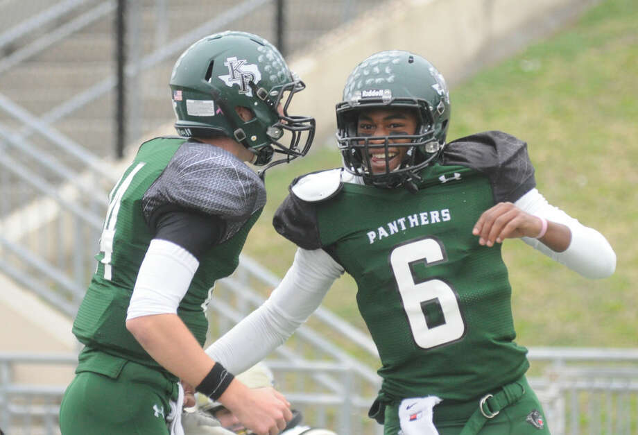 Kingwood Park quarterback Jaylon Henderson celebrates a touchdown with Zach Purcell against Nederland during a Region III-5A Division I bi-district game at Galena Park ISD Stadium on Saturday. Photo: Keith MacPherson