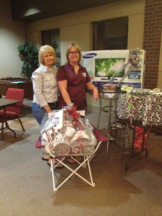 Gayle Keller and Geralyn Sullivan, KH Aggie Moms Tradition Banquet Chairpersons, pictured with some of the great raffle and auction items we will have at the banquet.