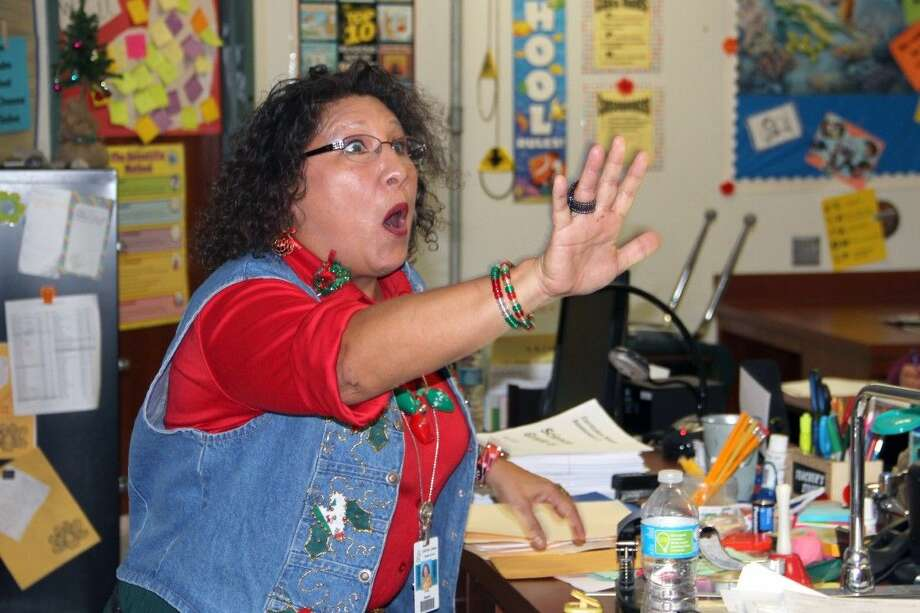Carter Lomax Middle School teacher Cynthia Martinez Bagwill is shocked by the Prize Parade team as she received a mini grant for her classroom for $4,890.