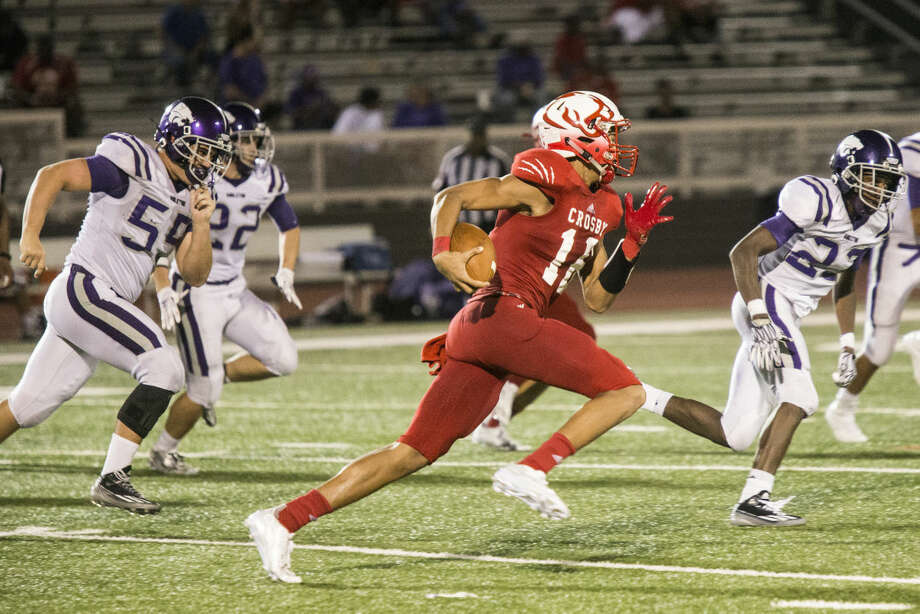 Cougars wide receiver Emmanuel Netherly (16) sprints up the field for a touchdown during Crosby's 34-0 victory over Angleton on Sep. 4, 2015, at Crosby High School. Photo: ANDREW BUCKLEY