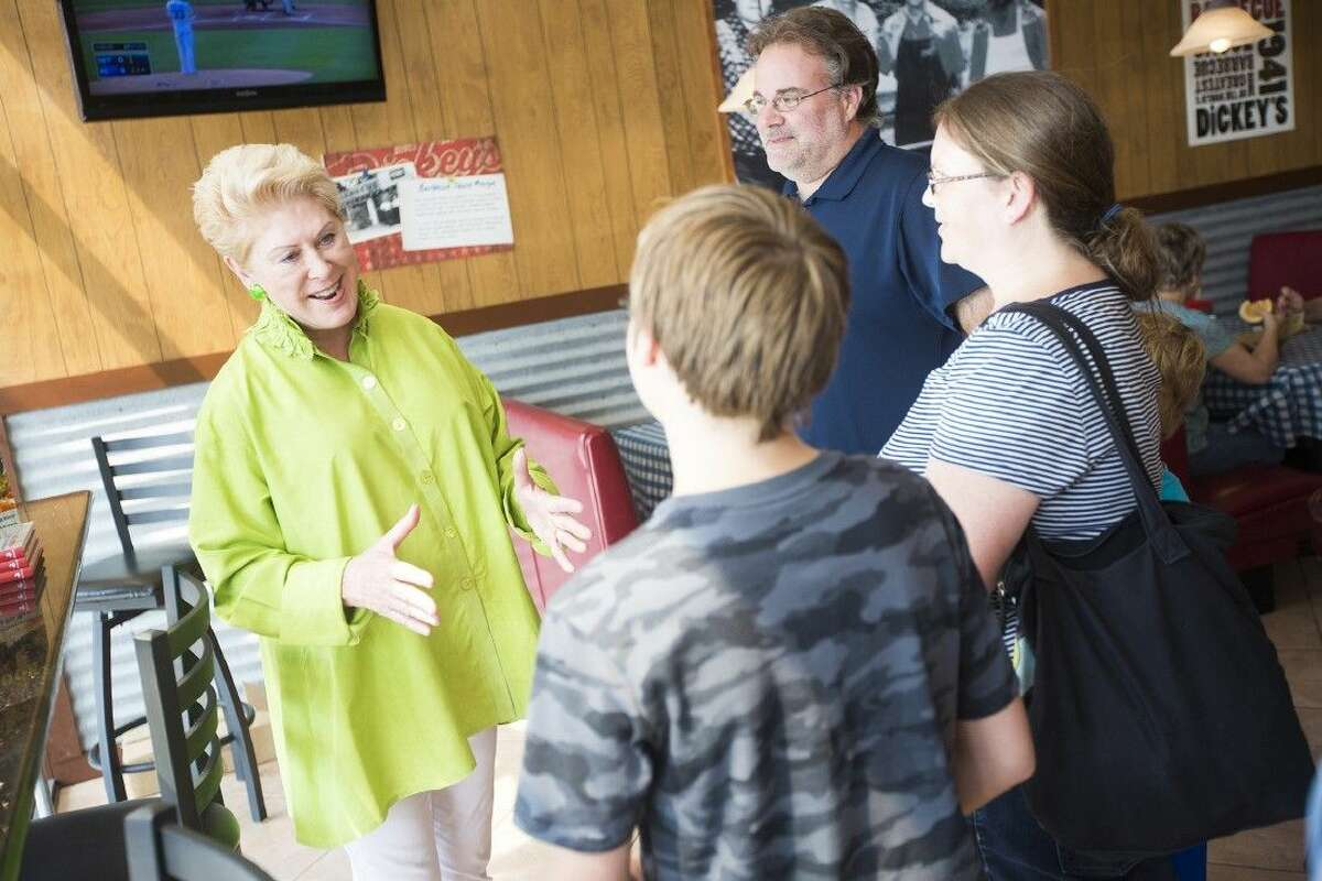 Maurine Dickey, matriarch of the Dickey family, talks with customers during a customer appreciation event Sept. 20, 2014, at Dickey's Barbecue Pit in Humble.