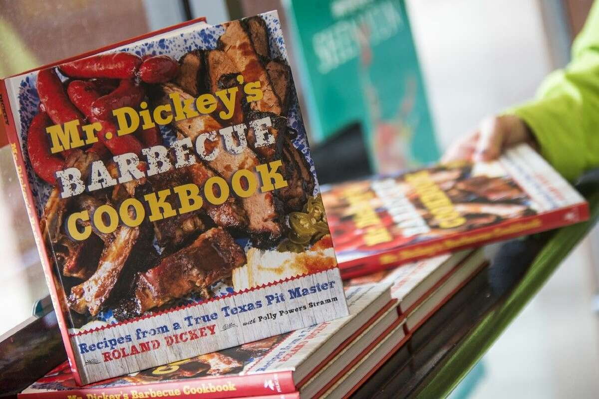 Cookbooks wait to be signed and handed out by Maurine Dickey, matriarch of the Dickey family, during a customer appreciation event Sept. 20, 2014, at Dickey's Barbecue Pit in Humble.