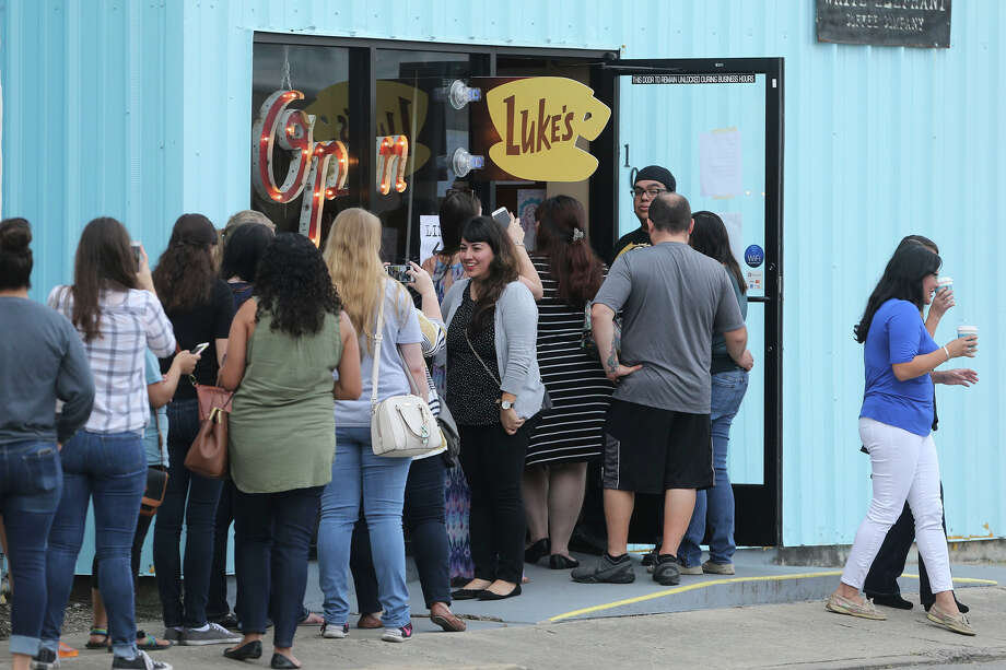 People wait in line for a free coffee at Luke's Diner at 107 Carolina Wednesday October 5, 2016. Photo: John Davenport