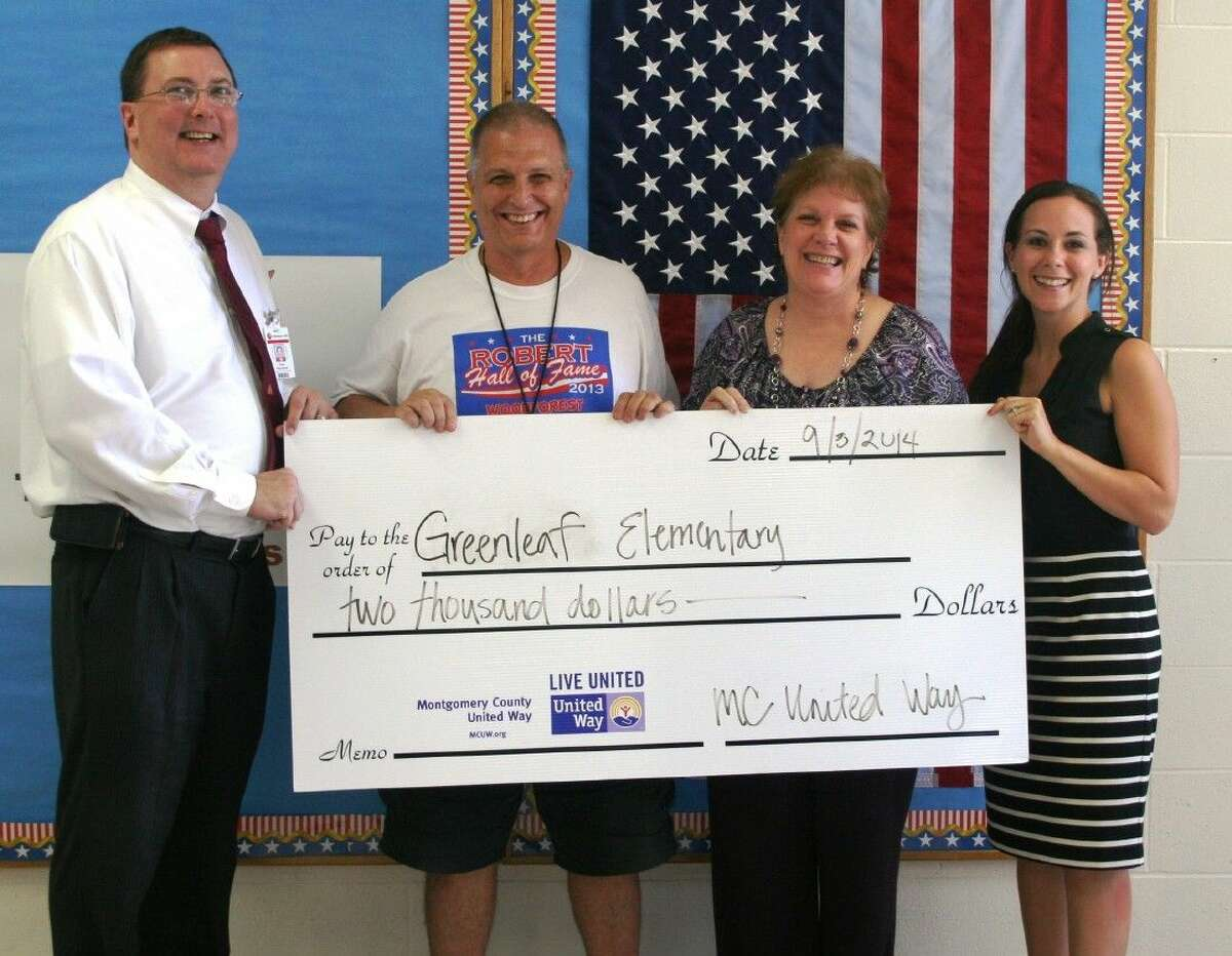 Troy Reynolds, director of curriculum and federal program for Splendora ISD, along with Coach William Horewitch and Greenleaf Elementary Principal Dr. Carolyn King, was on hand to accept a check for $10,000 from Montgomery County United Way representative Candace Rocquette to help kick off the Healthy Me program.