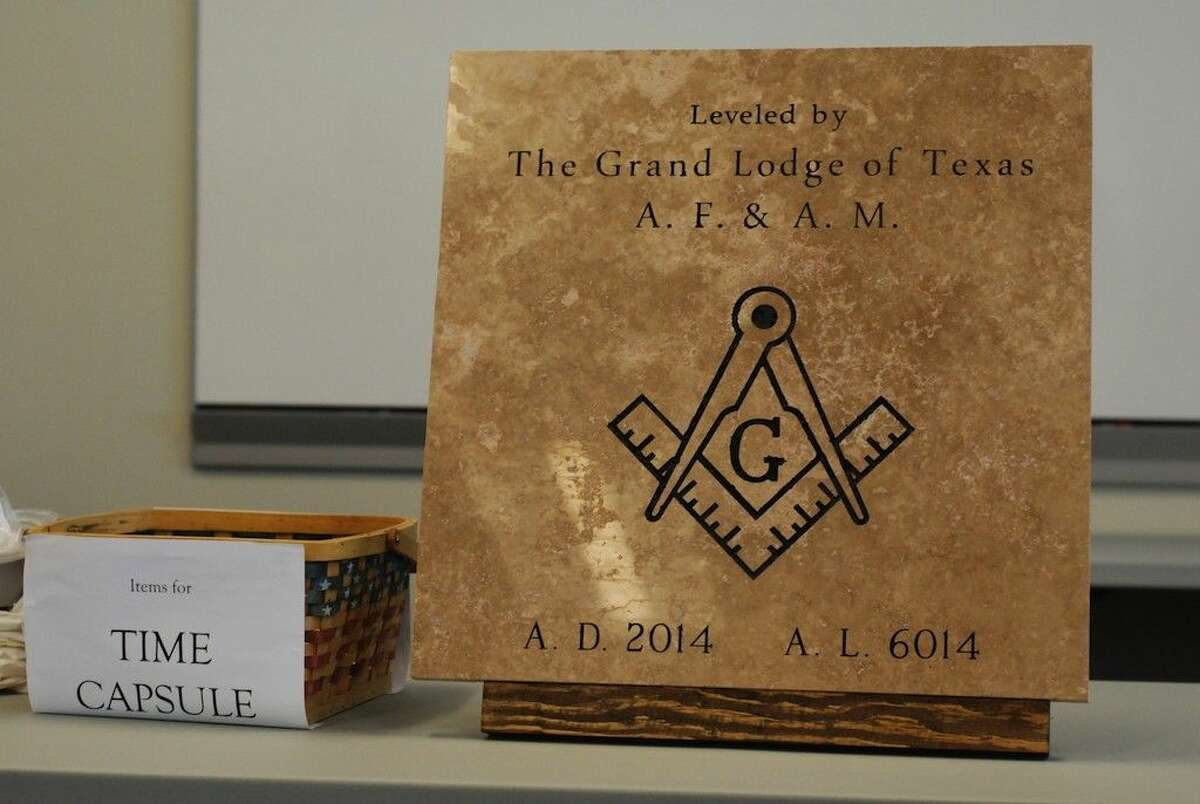 The Grand Lodge of Texas dedicated this cornerstone for the new Liberty, Texas, police station at a ceremony held Sept. 20. Items for a time capsule were collected to be placed behind the stone.