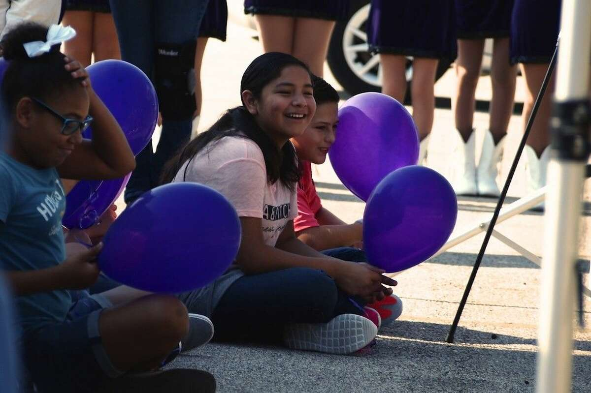 Dayton sixth graders wait to release balloons during the ground breaking ceremony, Aug. 27, at Woodrow Wilson Junior High.