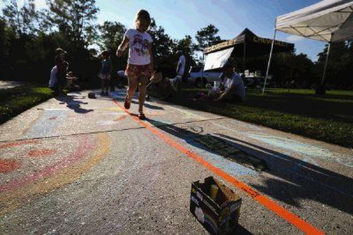 Families compete in the 4th Annual Family Sidewalk Chalk Competition on Sunday, Sept. 21, 2014, at Northshore Park in The Woodlands.