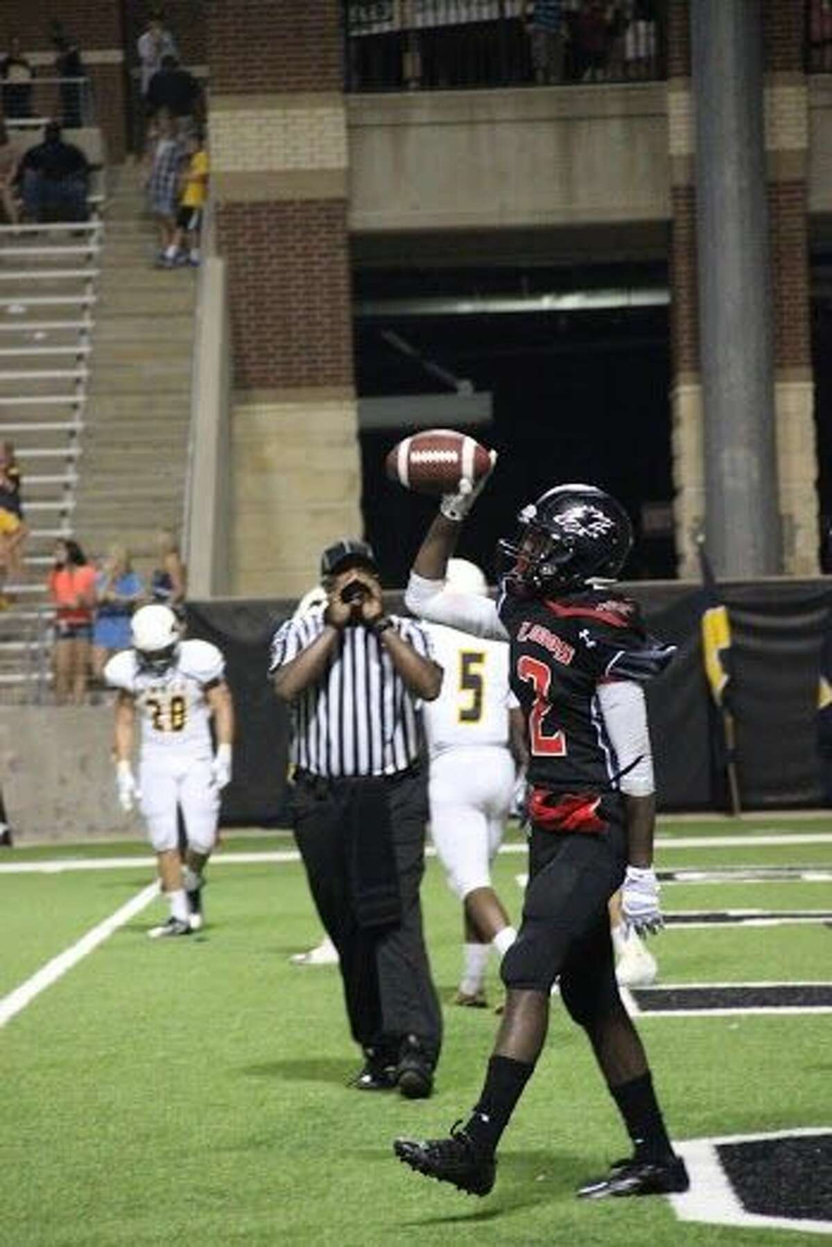 Langham Creek's Quartney Davis caught a 19-yard touchdown pass as time expired in a 42-39 win over Cy Ranch on Saturday at the Berry Center.
