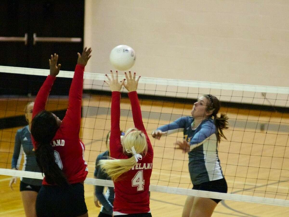 Liberty's Sommer Miles hits one passed Cleveland's blockers for one of her four kills in the match.