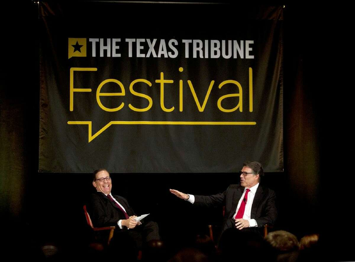 Texas Governor Rick Perry, right, talks with Texas Tribune CEO and editor in chief Evan Smith at the Texas Tribune Festival in Austin, Texas, on Sunday, Sept. 21, 2014. Perry on Sunday invoked comedian Joan Rivers' death at a surgical clinic while defending a law he signed that would close the majority of abortion facilities in Texas. Perry was the keynote speaker on the final day of the festival.