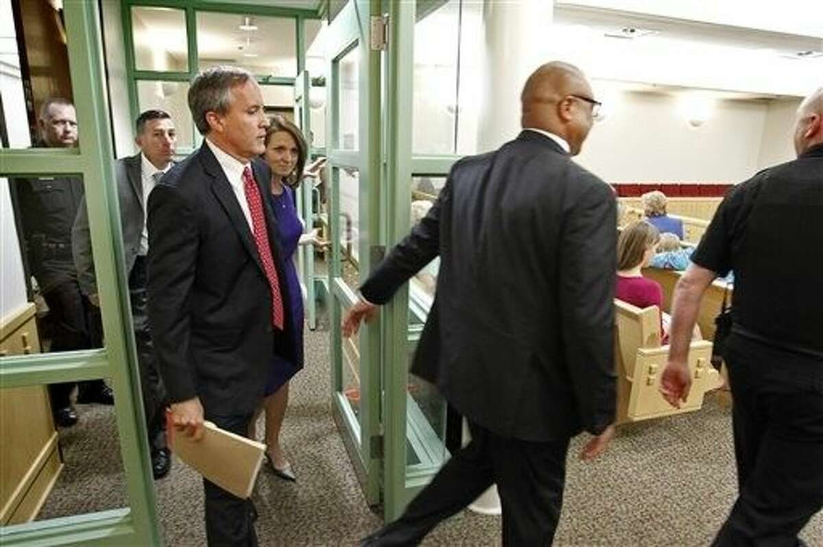 Texas Attorney Gen. Ken Paxton pleaded not guilty Thursday to charges alleging that he defrauded investors before he became the state's top lawyer, and his attorney Joe Kendall announced that he would no longer represent him.