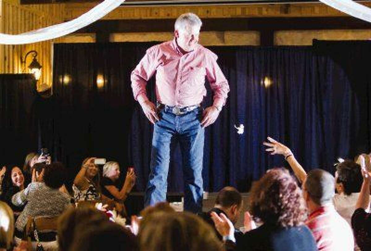 Montgomery County Judge Craig Doyal walks down the catwalk during the Real Men of Montgomery County Style Show Thursday. The event benefited CASA Child Advocates of Montgomery County. Go to HCNpics.com to view more photos from the event.