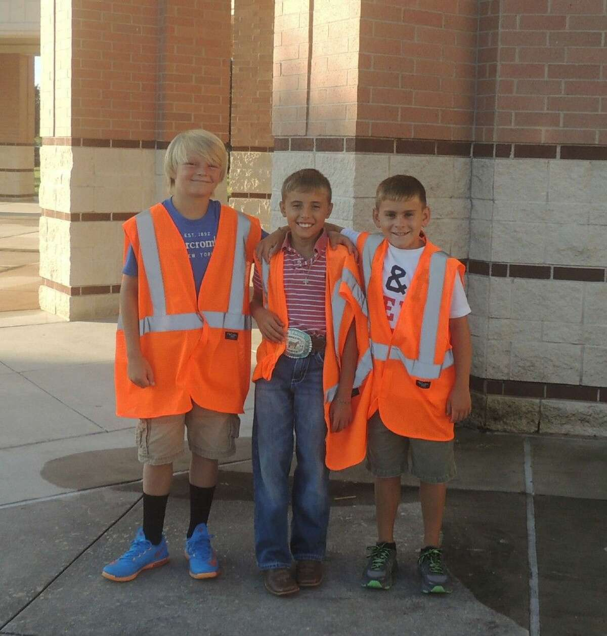 Ashton Garner, Jake Williams, and Nick Kopecky welcome students, staff and visitors.