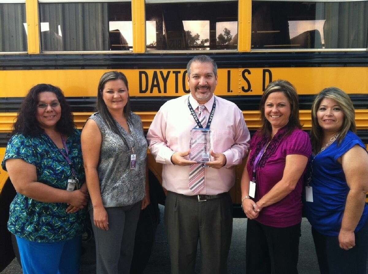 Members of the Dayton ISD's Transportation Department accept the