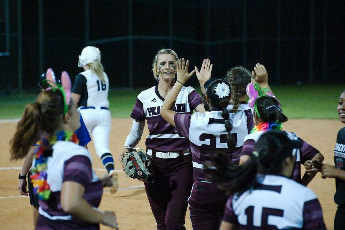 Teammates congratulate Pearland's Alyssa Denham (18) after her complete-game performance against Clear Springs.