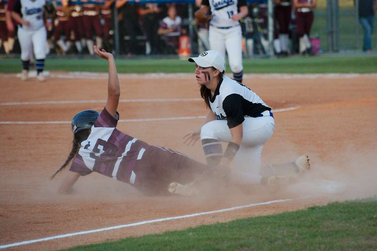 Clear Springs' Andrea Hern (10) looks for the umpire's call as Pearland's Lauren Shepherd (13) slides into third base Friday.